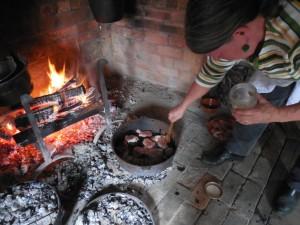Sautéing pork with the bear fat slurry.